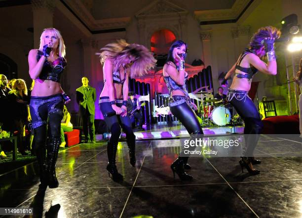 """Darling Stilettos perform onstage at the grand opening of """"Pandora"""" at Vibiana on October 27, 2009 in Los Angeles, California."""