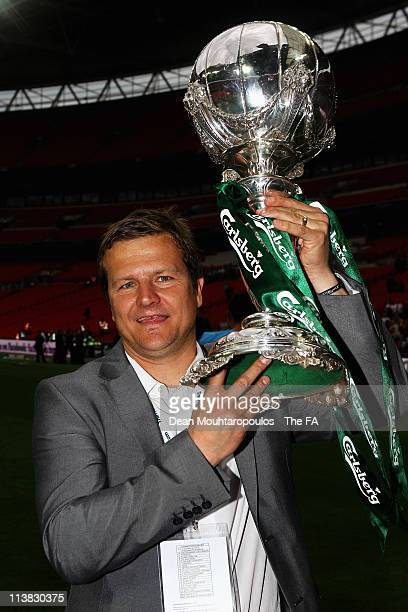 Darlington Manager, Mark Cooper holds the trophy after winning the FA Trophy Final between Darlington and Mansfield Town at Wembley Stadium on May 7,...