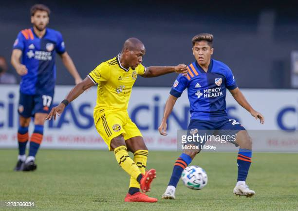 Darlington Nagbe of Columbus Crew passes the ball against Kendall Waston of FC Cincinnati during the game against the FC Cincinnati at Nippert...