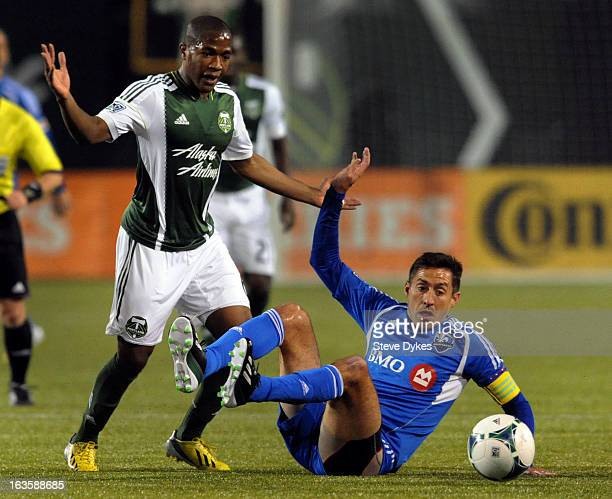 Darlington Nagbe of Portland Timbers goes after a ball with Davy Arnaud of Montreal Impact during the first half of the game at JeldWen Field on...