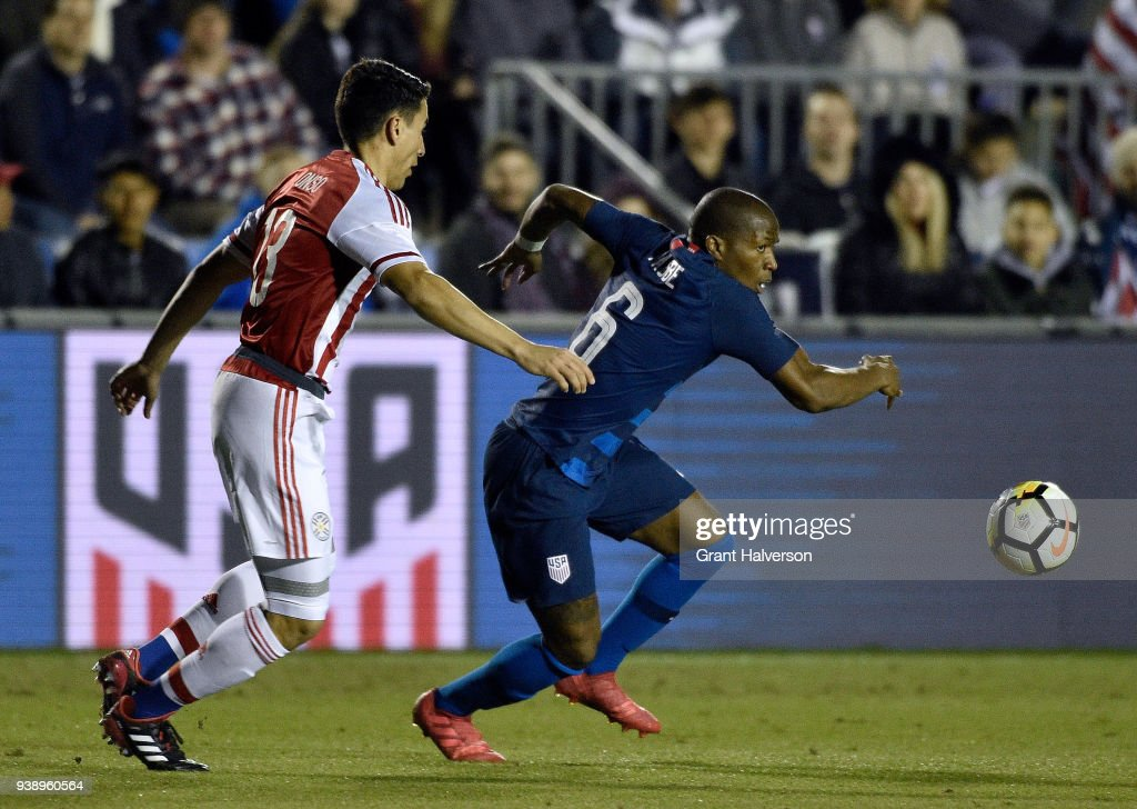 Darlington Nagbe #6 of United States moves the ball against Junior Alonso #13 of Paraguay during their game at WakeMed Soccer Park on March 27, 2018 in Cary, North Carolina.