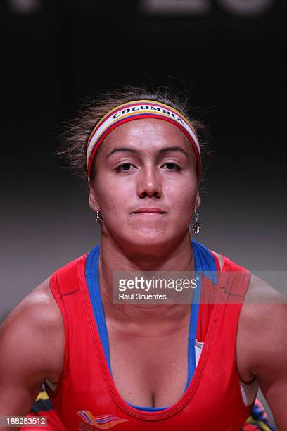 Darly Isabel Sanchez of Colombia A competes in the Women's 63 kg during day four of the 2013 Junior Weightlifting World Championship at Maria Angola...