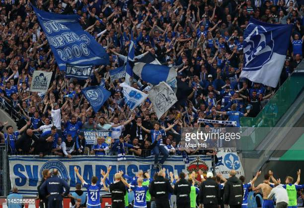 Darmstadt players and fans celebrate victory after the Second Bundesliga match between 1. FC Koeln and SV Darmstadt 98 at RheinEnergieStadion on...