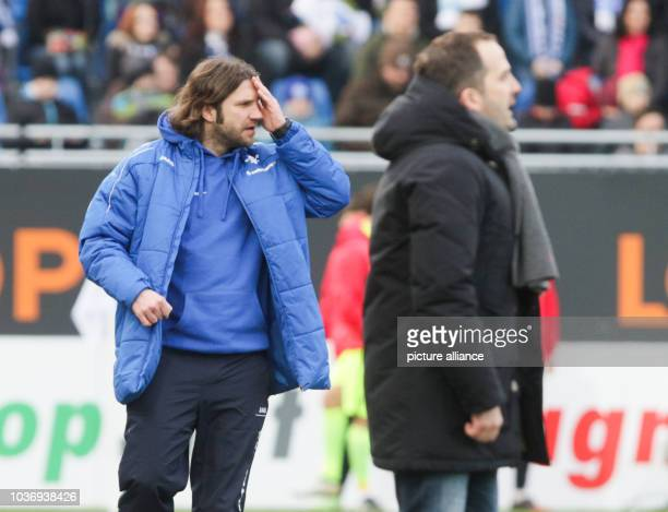 Darmstadt's coach Torsten Frings on the sidelines, to the right Augsburg coach Manuel Baum during the German Bundesliga soccer match between...