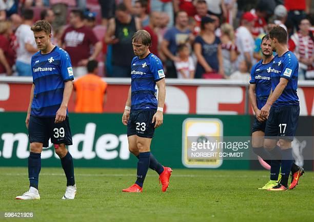 Darmstadt's defender Johannes Wolff Darmstadt's midfielder Florian JungwirthDarmstadt's midfielder Marcel Heller and Darmstadt's defender Sandro...
