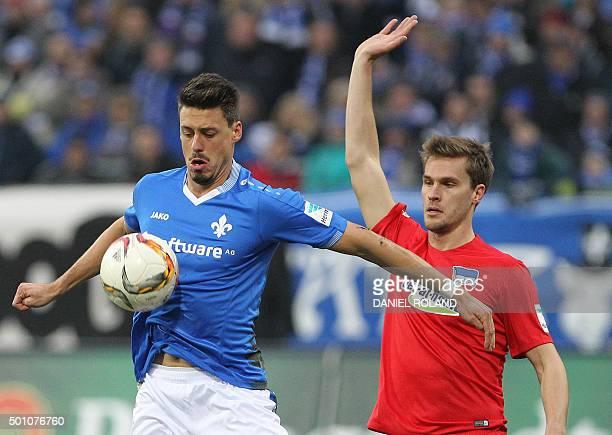 Darmstadt's forward Sandro Wagner and Hertha's defender Sebastian Langkamp vie for the ball during the German first division Bundesliga football...