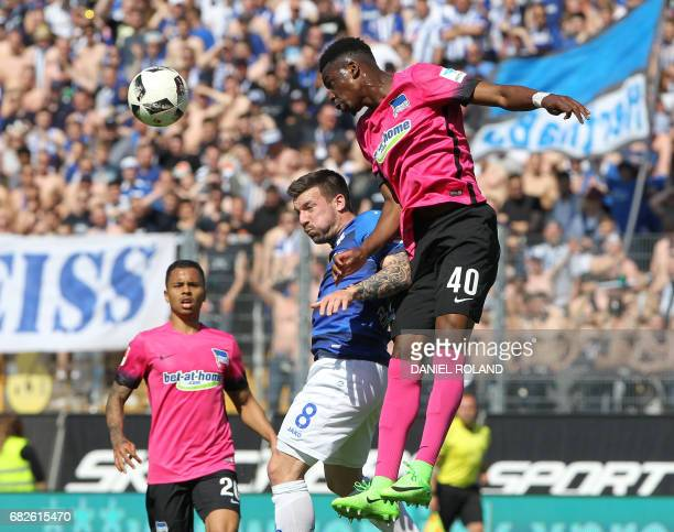 Darmstadt's midfielder Jerome Gondorf and Berlin's defender Jordan Torunarigha vie for the ball during the German first division Bundesliga football...
