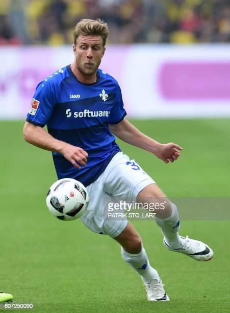 Darmstadt's Swedish defender Göran Alexander Sjoestroem Milosevic controls the ball during the German first division Bundesliga football match of...