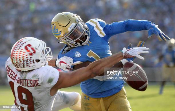 Darnay Holmes of the UCLA Bruins breaks up a pass intended for JJ ArcegaWhiteside of the Stanford Cardinal during the second half of a game at the...