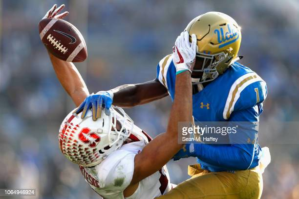 Darnay Holmes of the UCLA Bruins breaks up a pass play intended for JJ ArcegaWhiteside of the Stanford Cardinal during the second half of a game at...