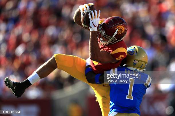 Darnay Holmes of the UCLA Bruins defends as Michael Pittman Jr #6 of the USC Trojans makes a catch during the first half of a game at Los Angeles...