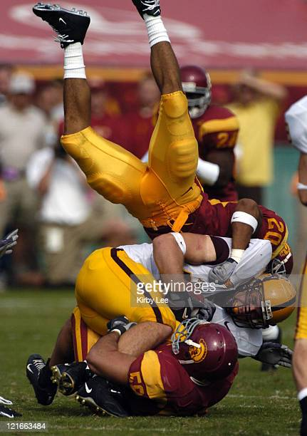 Darnell Bing and Lofa Tatupu sack Arizona State quarterback Andrew Walter during 457 victory in Pacific10 Conference football game at the Los Angeles...