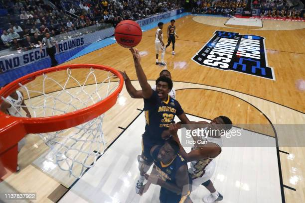 Darnell Cowart of the Murray State Racers attempts a shot against the Florida State Seminoles in the first half during the second round of the 2019...