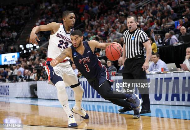 Darnell Edge of the Fairleigh Dickinson Knights drives against Zach Norvell Jr #23 of the Gonzaga Bulldogs during the first half in the first round...