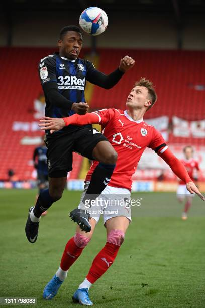 Darnell Fisher of Middlesbrough heads the ball ahead of Cauley Woodrow of Barnsley FC during the Sky Bet Championship match between Barnsley and...