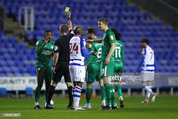 Darnell Fisher of Preston North End is shown a yellow card after fouling Sone Aluko of Reading during the Sky Bet Championship match between Reading...