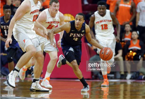 Darnell Foreman of the Pennsylvania Quakers dribbles the ball up court during a game against the Princeton Tigers at The Palestra during the...