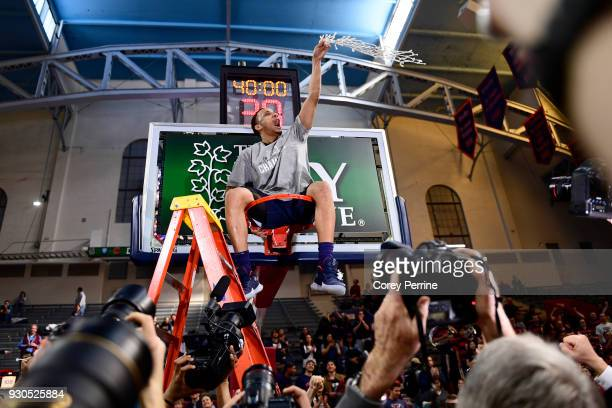 Darnell Foreman of the Pennsylvania Quakers sits atop the cylinder after the win of the Men's Ivy League Championship Tournament at The Palestra on...