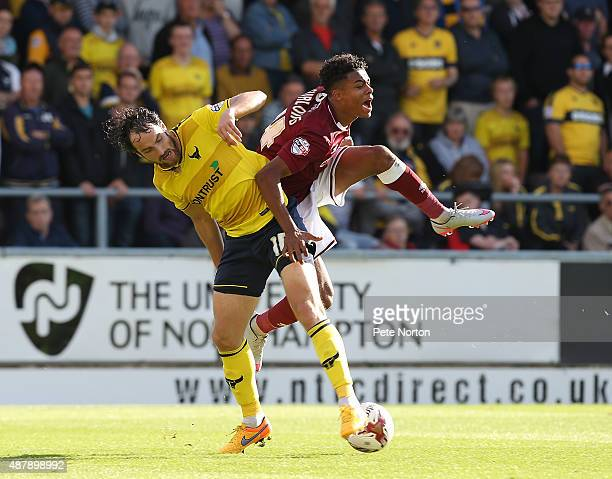 Darnell Furlong of Northampton Town attempts to clear the ball under pressure from Danny Hylton of Oxford United during the Sky Bet League two match...