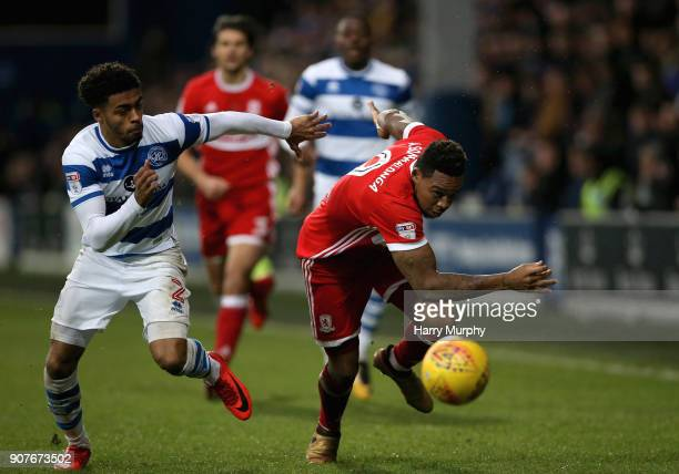 Darnell Furlong of Queens Park Rangers and Britt Assombalonga of Middlesbrough battle for possession during the Sky Bet Championship match between...