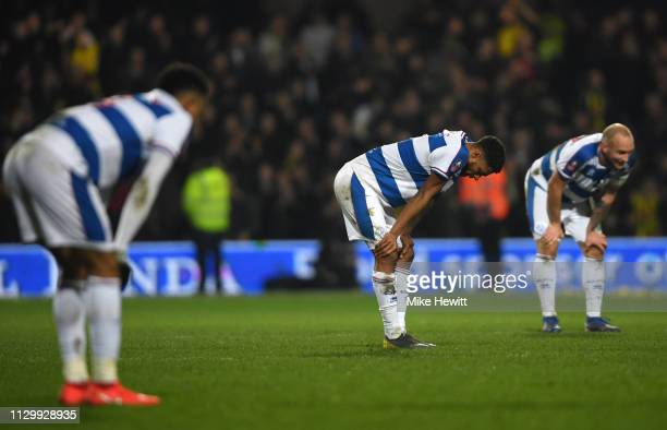 Darnell Furlong of Queens Park Rangers and team mates look dejected in defeat after the FA Cup Fifth Round match between Queens Park Rangers and...