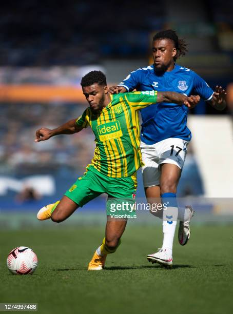 Darnell Furlong of West Bromwich Albion and Alex Iwobi of Everton in action during the Premier League match between Everton and West Bromwich Albion...