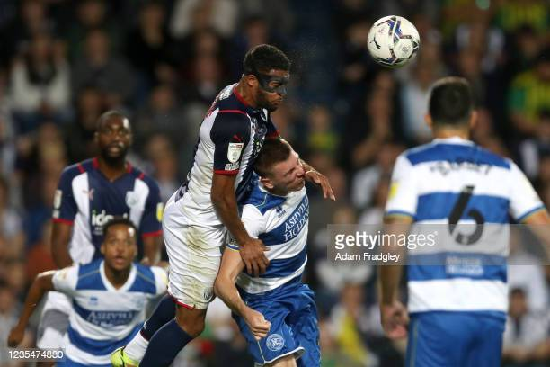 Darnell Furlong of West Bromwich Albion and Jimmy Dunne of Queens Park Rangers during the Sky Bet Championship match between West Bromwich Albion and...