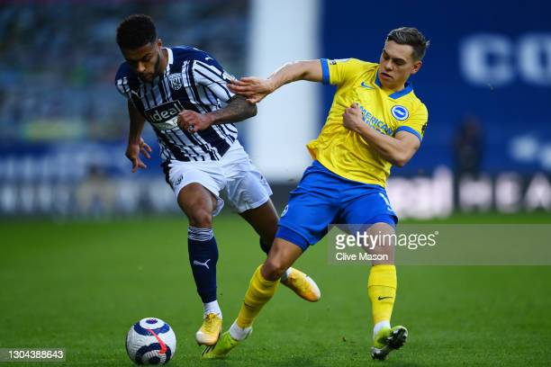 Darnell Furlong of West Bromwich Albion and Leandro Trossard of Brighton and Hove Albion battle for possession during the Premier League match...