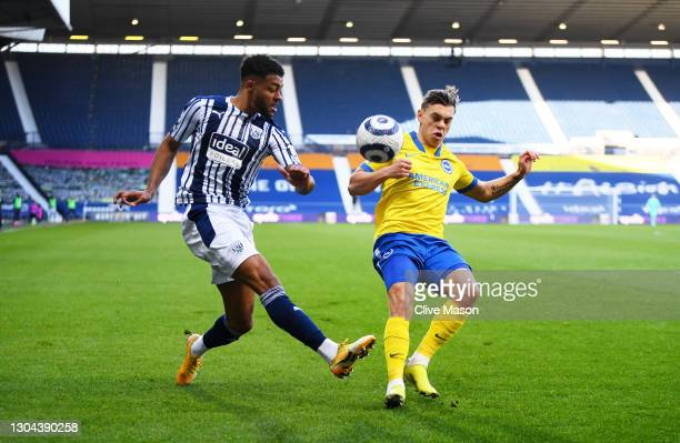 Darnell Furlong of West Bromwich Albion is challenged by Leandro Trossard of Brighton and Hove Albion during the Premier League match between West...