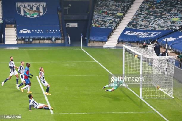 Darnell Furlong of West Bromwich Albion scores an own goal past Sam Johnstone of West Bromwich Albion to make it the first goal for Crystal Palace...