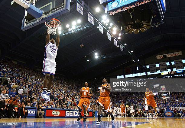 Darnell Jackson of the Kansas Jayhawks dunks during the first half of the game against the Texas Longhorns on March 3, 2007 at Allen Fieldhouse in...