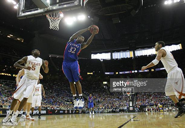 Darnell Jackson of the Kansas Jayhawks rebounds the ball against the Texas Longhorns during the Big 12 Men's Basketball Tournament Finals on March 16...