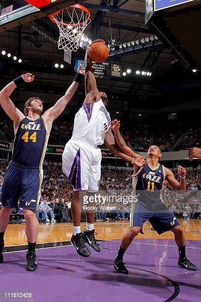 Darnell Jackson of the Sacramento Kings rebounds the ball against Kyrylo Fesenko of the Utah Jazz on April 3 2011 at Power Balance Pavilion in...