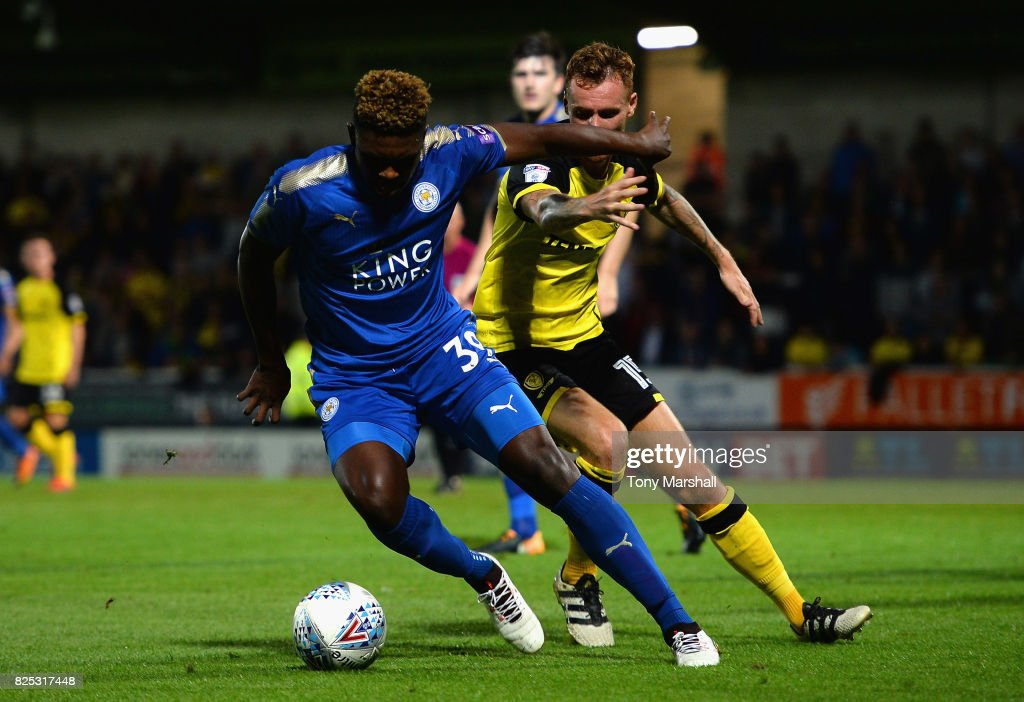Darnell Johnson of Leicester City is tackled by Tom Naylor of Burton Albion during the Pre-Season Friendly match between Burton Albion v Leicester City at Pirelli Stadium on August 1, 2017 in Burton-upon-Trent, England.