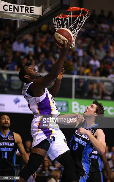 Darnell Lazare of the Kings shoots under pressure from Tom Abercrombie of the Breakers during the round five NBL match between the New Zealand...