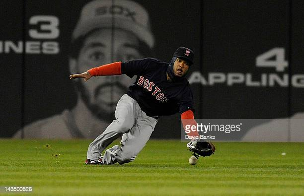 Darnell McDonald of the Boston Red Sox can't make a sliding catch in the third inning against the Chicago White Sox on April 27 2012 at US Cellular...