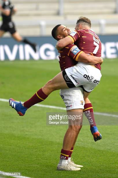 Darnell McIntosh of Huddersfield Giants celebrates with team mate Aidan Sezer of after scoring his sides fourth try during the Betfred Super League...