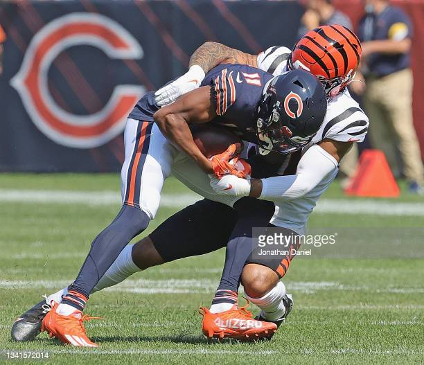 Darnell Mooney of the Chicago Bears is tackled by Jessie Bates of the Cincinnati Bengals after a catch at Soldier Field on September 19, 2021 in...