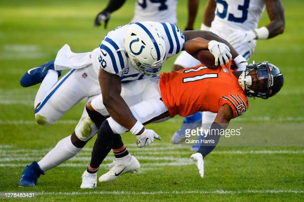 Darnell Mooney of the Chicago Bears is tackled in the second quarter by Justin Houston of the Indianapolis Colts at Soldier Field on October 04 2020...