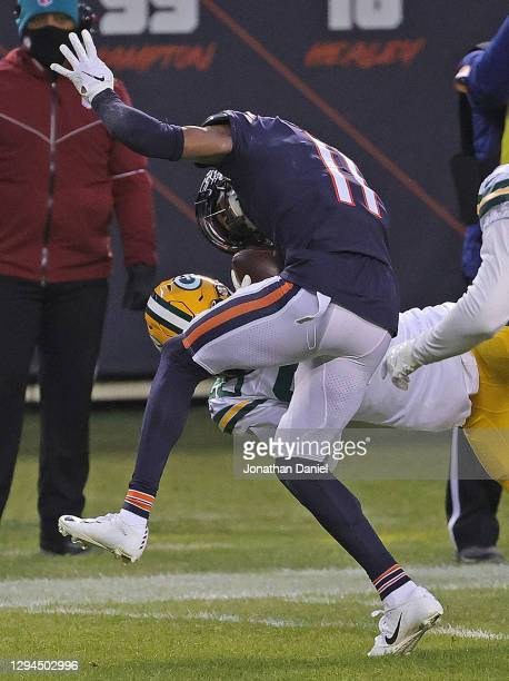 Darnell Mooney of the Chicago Bears is taken down by Kevin King of the Green Bay Packers at Soldier Field on January 03, 2021 in Chicago, Illinois....