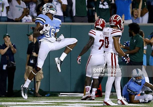 Darnell Mooney of the Tulane Green Wave celebrates a touchdown during double overtime of a game against the Louisiana-Lafayette Ragin Cajuns at...