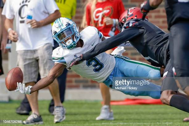 Darnell Mooney of the Tulane Green Wave reaches for the ball as Coby Bryant of the Cincinnati Bearcats at Nippert Stadium on October 6, 2018 in...