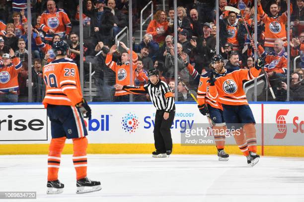 Darnell Nurse and Leon Draisaitl of the Edmonton Oilers celebrate after a goal during the game against the Minnesota Wild on December 7 2018 at...