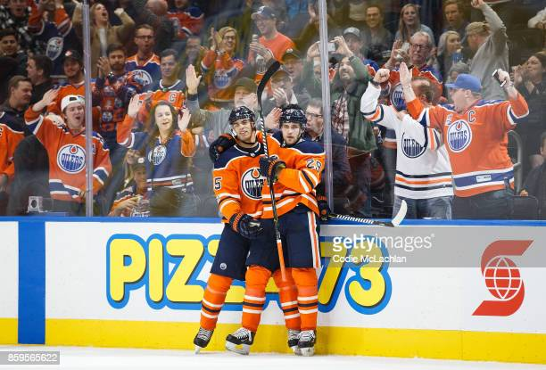 Darnell Nurse and Leon Draisaitl of the Edmonton Oilers celebrate Draisaitl's goal against the Winnipeg Jets at Rogers Place on October 9 2017 in...