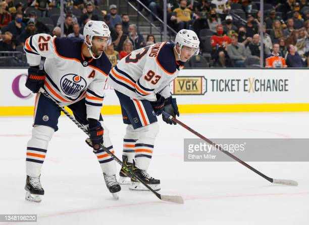 Darnell Nurse and Ryan Nugent-Hopkins of the Edmonton Oilers wait for a faceoff in the second period of a game against the Vegas Golden Knights at...