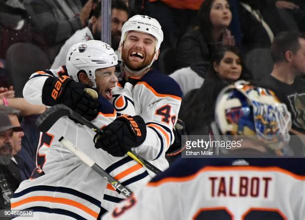 Darnell Nurse and Zack Kassian of the Edmonton Oilers celebrate after Nurse scored an overtime goal against the Vegas Golden Knights to win their...