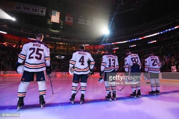 Darnell Nurse Kris Russell Michael Cammalleri Connor McDavid Leon Draisaitl of the Edmonton Oilers stand for the National Anthem before a game...