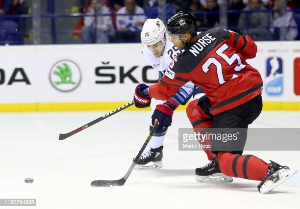 Darnell Nurse of Canada challenges James van Riemsdyk of United States during the 2019 IIHF Ice Hockey World Championship Slovakia group A game...