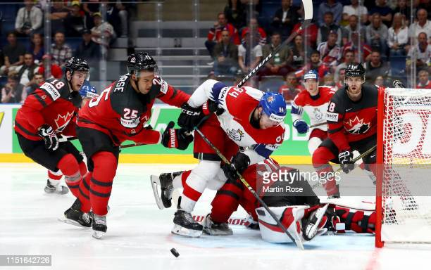 Darnell Nurse of Canada challenges Radek Faksa of Czech Republic during the 2019 IIHF Ice Hockey World Championship Slovakia semi final game between...