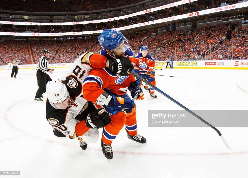 Darnell Nurse #25 of the Edmonton Oilers battles against Corey Perry #10 of the Anaheim Ducks in Game Three of the Western Conference Second Round during the 2017 NHL Stanley Cup Playoffs at Rogers Place on April 30, 2017 in Edmonton, Alberta, Canada. The Ducks won 6-3.